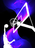 Basketball Slam Dunk. A silhouette of a basketball player slam dunking the ball over a swirly purple background Stock Photo