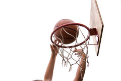 Basketball slam dunk. Hands young boy making basketball shot dank on white backgrounds Royalty Free Stock Image