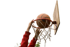 Basketball slam dunk. Hands young boy making basketball shot dank on white and green backgrounds Stock Photo