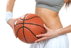 Basketball in slim woman basketball player hands. Stock Images