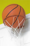 Basketball in Small Hoop Stock Photography