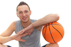 Basketball smile. Smiling basketball player resting on the  ball, isolated on white, other images in my portfolio Royalty Free Stock Photos