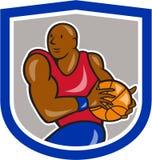 Basketball-Spieler, der Ball-Schild-Karikatur hält Lizenzfreie Stockfotografie