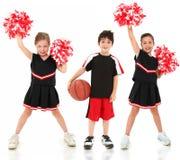 Basketball-Spieler-und Cheerleader-Kinder Stockbild