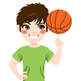 Basketball spinning Boy. Young boy spinning basketball ball with finger Stock Photos