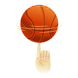 Basketball spinning on top of index finger Royalty Free Stock Image