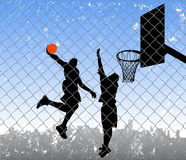 Basketball in the street Royalty Free Stock Images