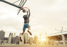 Basketball street player making a rear slam dunk. Royalty Free Stock Photos