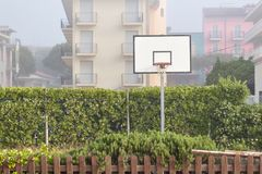 Basketball structure in an outdoor playground surrounded by trees in a park Royalty Free Stock Photography