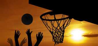 Basketball at sunset. Graphic projection showing the trash during the evening basketball game Stock Image