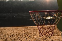 Basketball on the sunset beach. royalty free stock images