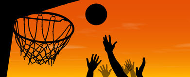 Basketball sunset match. Basketball match at sunset, hands silhouettes jumping to reach the ball Stock Photos