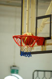 Basketball swishing hoop. A motion of basketball swishing through the hoop royalty free stock photo