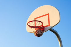 Basketball swoosh. A basketball shot swishes through the net Royalty Free Stock Image