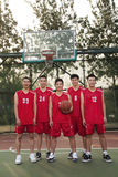 Basketball team standing and smiling, portrait Royalty Free Stock Photography