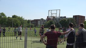 Basketball teams participate in street competition and support fans. 4K