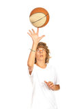 Basketball teen spinning on finger. Basketball teen boy player spinning ball on his finger isolated on white background Royalty Free Stock Images