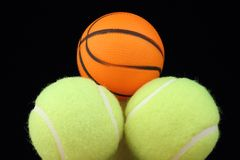 Basketball on tenis balls Stock Photography