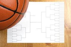 Basketball Tournament Bracket and Basketball. A blank basketball tournament bracket and a basketball Stock Photo