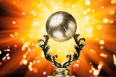 Basketball trophy against shiny background Royalty Free Stock Images