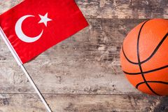 Basketball and Turkey flag on wooden table. Top view stock photography