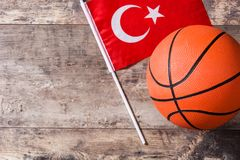 Basketball and Turkey flag on wooden table. Top view. Copyspace stock image