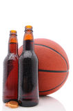 Basketball and two beer bottles Royalty Free Stock Photography