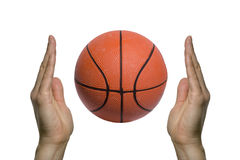 Basketball between two hands Royalty Free Stock Photo