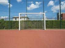 Basketball und Laufspielplatzabschluß herauf Makrofoto Stockbild