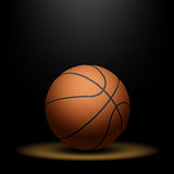 Basketball under spotlight Royalty Free Stock Image