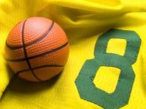 Basketball uniform and ball. Small ball on the number nine uniform Stock Image