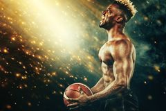 Basketball Wallpaper. Portrait of afro-american sportsman, basketball player with a ball over black background. Fit. Portrait of male basketball player with a stock photos