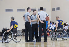 Basketball in wheelchairs for physically disabled players judges Royalty Free Stock Photos