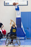 Basketball in wheelchairs for physically disabled players scorin Stock Photo