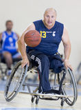 Basketball in wheelchairs for physically disabled players Stock Photos