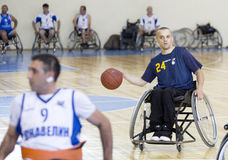 Basketball in wheelchairs for physically disabled players. Sofia, Bulgaria - May 16, 2015: Physically disabled people are playing basketball in the Sofia's Cup Royalty Free Stock Photo