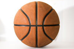 Basketball on white background. Old brown outdoor ball on white background Stock Image