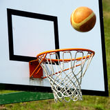 Basketball - Winning shot?. A basketball and a basketball hoop with net royalty free stock image