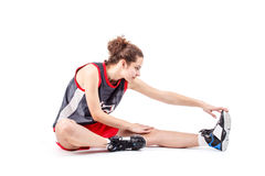Basketball woman stretching leg Stock Photo