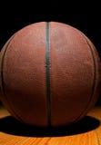 Basketball on wood Stock Photos