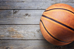 Basketball Wood Sport Background. Closeup of a basketball on an old wood floor Royalty Free Stock Image