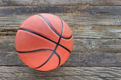 Basketball on wooden background Royalty Free Stock Photos