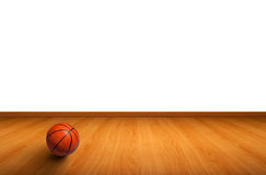 A basketball on wooden floor. A basketball on the wooden floor as background Royalty Free Stock Photos