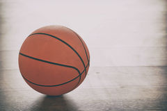 Basketball on wooden floor. Basketball on a wooden court floor Royalty Free Stock Image