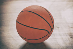 Basketball on wooden floor. Basketball on a wooden court floor Royalty Free Stock Images