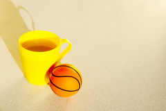 Basketball with yellow cup juice in the morning Royalty Free Stock Photos