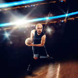 Basketballer in action with a ball Stock Photography