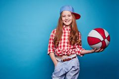 Basketballer. Cute girl with basketball looking at camera Stock Photos