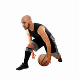 Basketballer dribbles on white background Royalty Free Stock Images