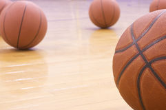 Basketballs. Five basketballs on gym floor Stock Images
